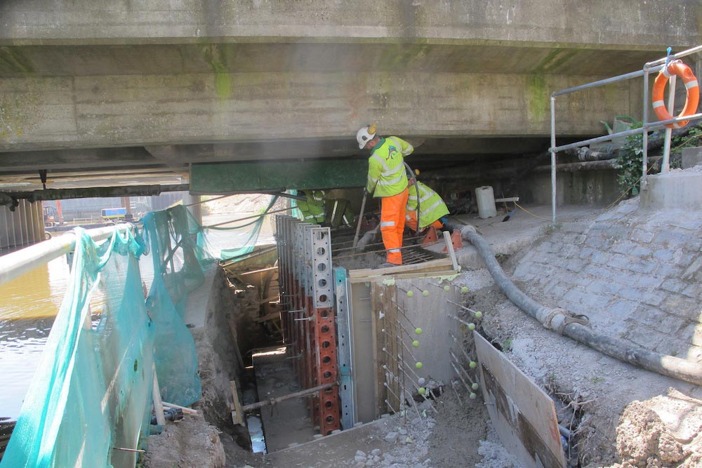 "Contractors Removing The Historic ""lump Of Concrete"" From Under Dunball Old Bridge."