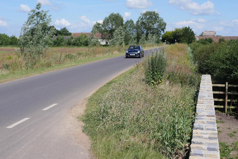 Car Driving Along Muchelney's Raised Road.