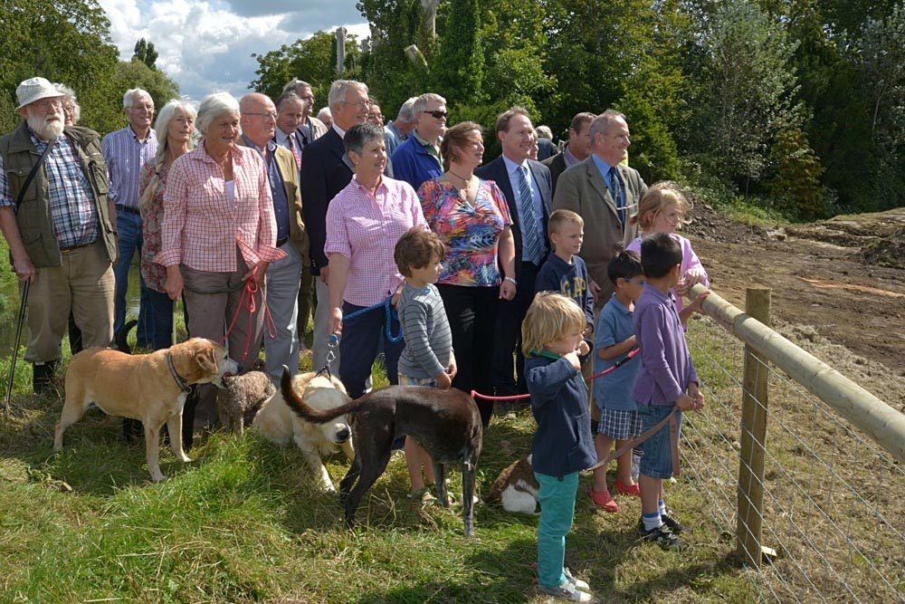 Spectators Including SRA Board Members, Local Councillors, And Residents By Fence Marking Off Start Of Thorney Ring Bank Work.
