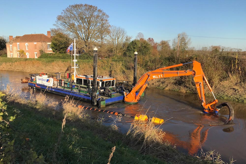 Van Oord Water Injection Dredging Vessel Borr, On The River Parrett With Its Front Cutter Arm And Suction Hose Extended In The Water.