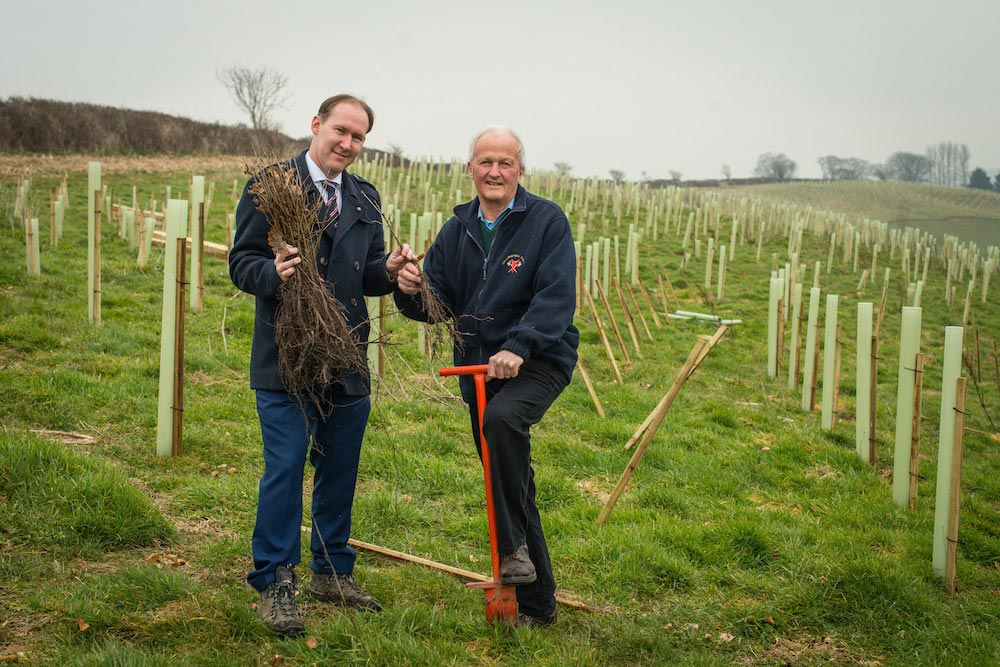 Somerset Rivers Authority Chair Cllr John Osman with Lord Cameron planting trees on Lord Cameron's Dillington estate near Ilminster.