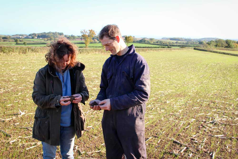 FWAG SW advisor Jo Oborn and Chris Ford of Peadon Farm near Nether Stowey look at soil samples in a field where maize had been planted