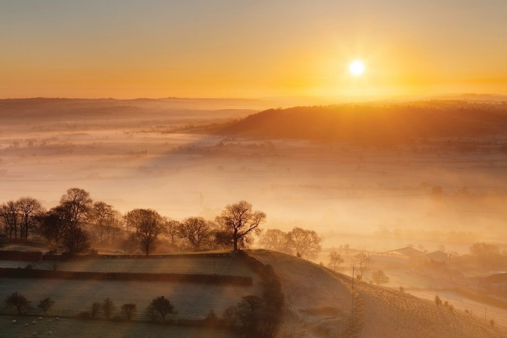 Sun Rising Over Hills And Mist On The Somerset Levels