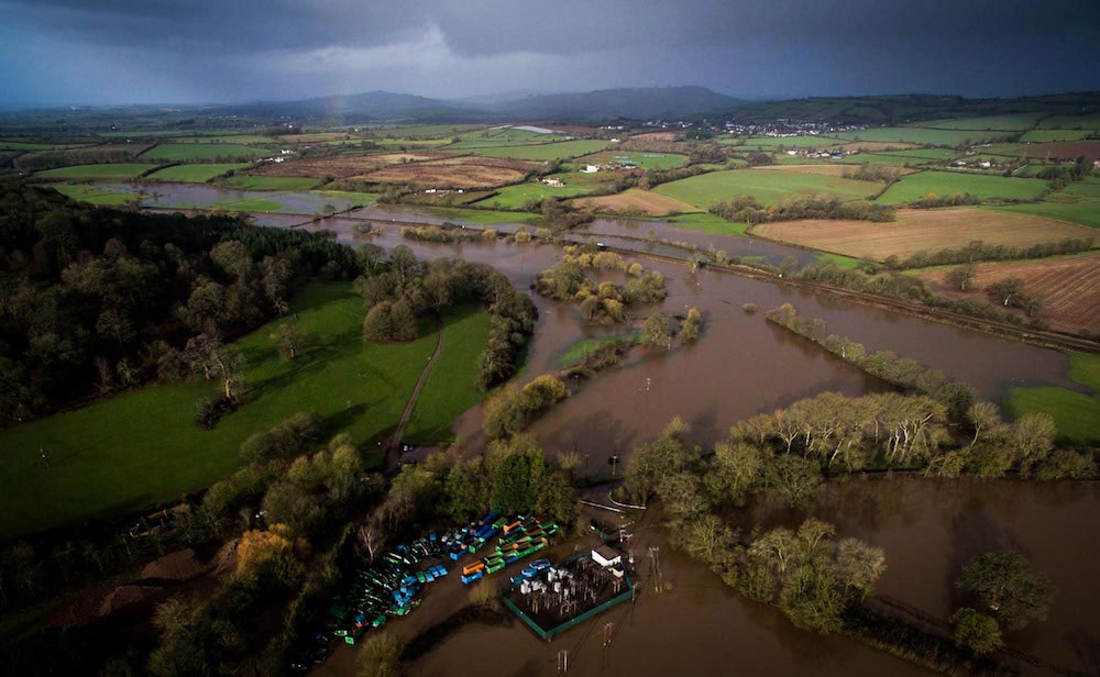 Aerial view of water overflowing from River Culm.