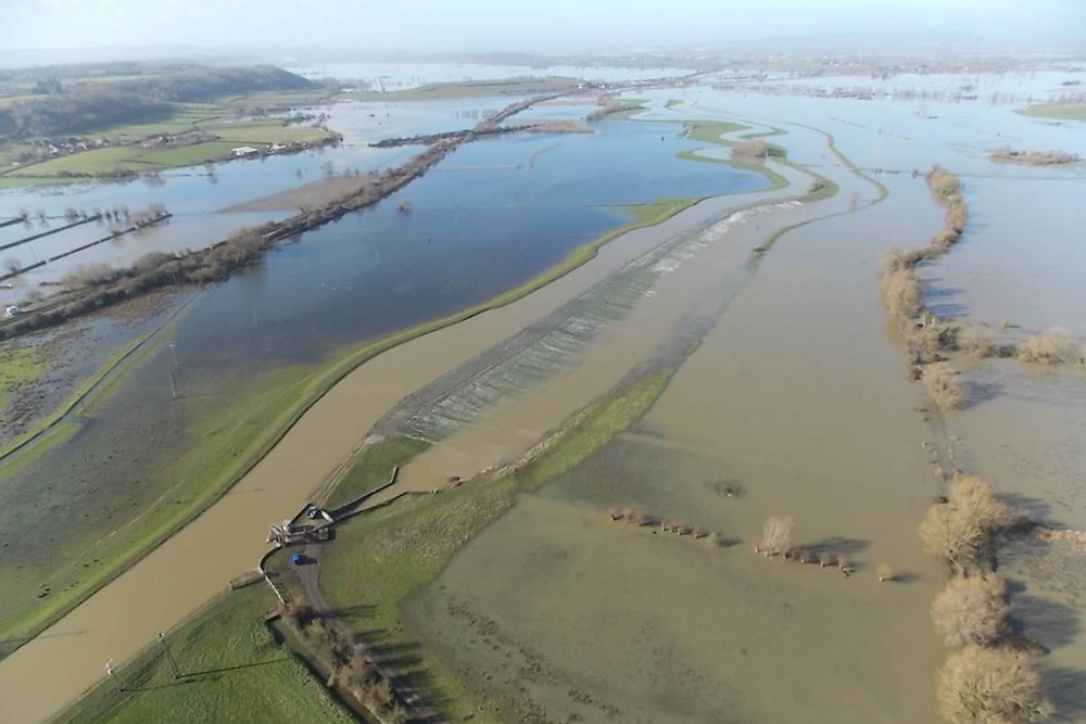 Aerial View In Time Of Flood Of The River Parrett's Intersection With The River Sowy At Monk's Leaze Clyse Near Aller On The Somerset Levels.