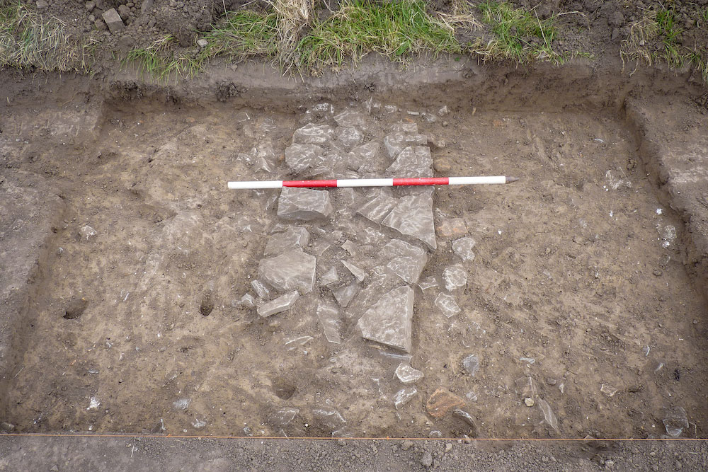 Part of probable tenement wall neatly exposed, with measuring stick, at the lost Somerset hamlet of Tappingweir near the River Parrett not far from Burrowbridge.